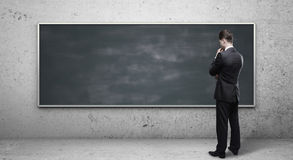 Man looking at blackboard Stock Photography