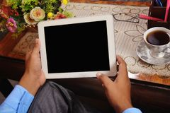 Man looking at blank tablet pc screen Stock Photography