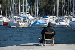 A man looking boats Stock Photography