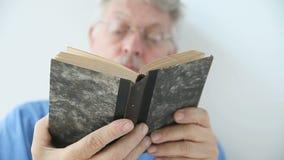 Man looking through a book stock video