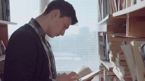 Man looking through the book stock video footage