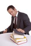 Man looking at books Royalty Free Stock Photo
