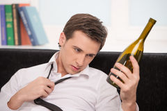 Man looking at the bottle Royalty Free Stock Photography
