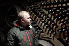 Man in wine cellar Stock Photo