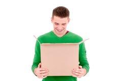Man looking into box Royalty Free Stock Image
