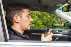 Man looking at breathalyzer Royalty Free Stock Photo