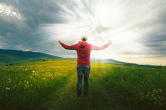 Man looking at bright light. Man waiting for a miracle Royalty Free Stock Images