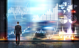 Man looking at business chart. Businessman looking at abstract business chart on blurry city background. Fund management concept Royalty Free Stock Image