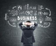 Man looking at business idea scheme Stock Photo