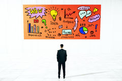 Man looking at business sketch Stock Photo
