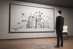 Man looking at business sketch. Back view of young businessman in brick interior looking at frame with business sketch. Income concept. 3D Rendering Royalty Free Stock Photography