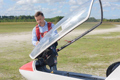 Man looking at cab sailplane. Man looking at cab of sailplane Royalty Free Stock Image