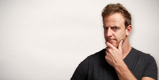 Man looking camera with doubt. Close-up of man face incomprehension and doubt expression Royalty Free Stock Photos