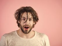 Man looking at camera. Handsome man face. Morning washing, wake up, everyday life. Man splash water at face on pink background. Hygiene, guy wash surprised Stock Images