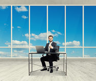 Man looking at camera in the light office Royalty Free Stock Photo
