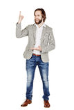 Man looking at camera and pointing finger up. image isolated ove Royalty Free Stock Photo