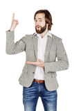 Man looking at camera and pointing finger up. image isolated ove Stock Image