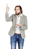 Man looking at camera and pointing finger up. image isolated ove Royalty Free Stock Images