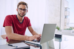 Man looking at camera while working from home Royalty Free Stock Photo