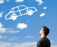 Man looking at car cloud on a blue sky Stock Images