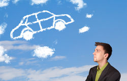 Man looking at car cloud on a blue sky. Handsome young man looking at car cloud on a blue sky stock images