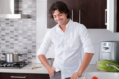 Man looking casual in kitchen. Portrait of happy man in the kitchen royalty free stock image