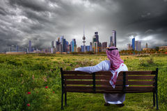 A man looking at the city from a garden Royalty Free Stock Image