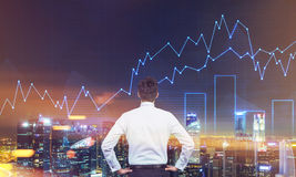 Man looking at city with graphs in the sky, toned royalty free stock photo
