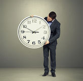 Man looking at clock dial Stock Images