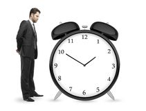 Man looking at clock Stock Photo