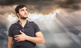 Man looking the cloudy sky. Man looking the sky with sunbeams and clouds Stock Photo