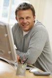 Man Looking At Computer Screen. At Home Stock Photo