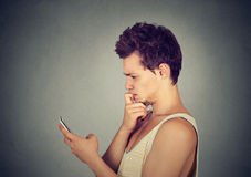 Man looking confused at his mobile phone Stock Images