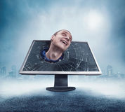 Man looking from cracked monitor Stock Images