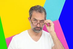 Man looking critical with colorful background. Portrait of man looking critical with colorful background royalty free stock image