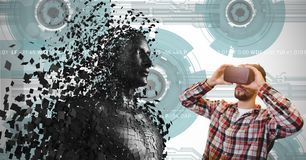 Man looking at 3d scattered human figure on VR glasses Stock Photo