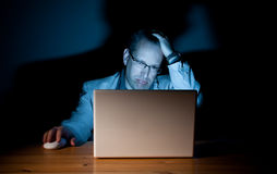 Demoralized computer guy. Man looking demoralized in front of his computer Royalty Free Stock Photo