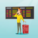 Man looking at departure board at the airport. Royalty Free Stock Images