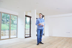 Man Looking At Details For Property He Hopes To Buy Royalty Free Stock Photo