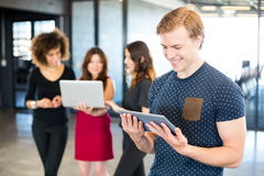 Man looking at digital tablet and smiling Royalty Free Stock Photos