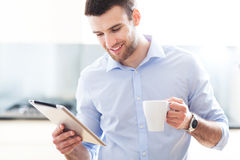 Man looking at digital tablet Royalty Free Stock Photo