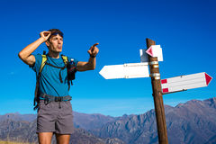 Man looking for direction at crossroad Stock Images