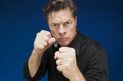Man looking directly at you with his fists to fight. Man looking directly at you with a lot of hatred and a will to fight Stock Photography