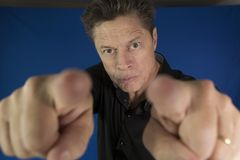 Man looking directly at you with his fists to fight Stock Photography