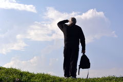 Man looking into the distance against the sky Stock Photos