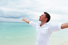 Man looking into the distance with his hands up Stock Photo
