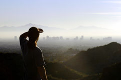 Man looking at distant city. Man looking at city in the distance with hope Stock Photography