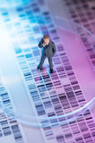Man looking at DNA gel. Into petri dish stock photography