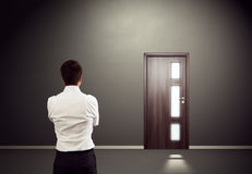 Man looking at the door Stock Images