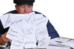 Man Looking Down At His Bills. Stock Photos